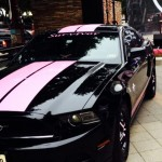 "Planet Ford ""In the Pink"" Mustang makes its debut at Hard Rock Cafe in Houston with its new owner, Gabriela Spellman, a breast cancer survivor."