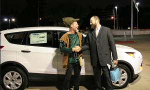Mr. Reed shows Mr. Duke his new Ford he received from Planet Ford.