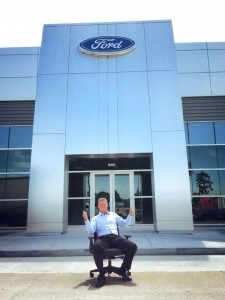 Randall Reed shows off the new exterior of Planet Ford in Humble.