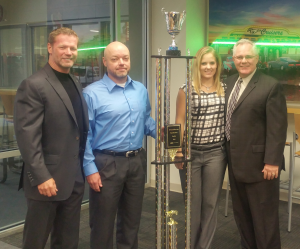 Left to Right: Randall Reed, owner; Jeff Stapp, Fixed Operations Dir., Shelby Reed, World Class; Chuck Kramer, GM/OP.
