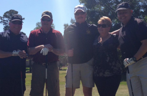 Kristi Williams, Community Relations Director, Harris County Sherriff Ron Hickman, Planet Ford team and golfers at The Village Learning Center golf tournament.